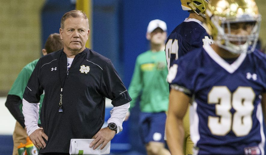 FILE - In this March 8, 2017, file photo, Notre Dame head coach Brian Kelly looks over his team during spring NCAA college football practice at the Loftus Sports Center in South Bend, Ind. This is a first for Notre Dame coach Brian Kelly. He has been a college head football coach for the last 27 years and until now he had never reached this fork in his career path: Get better or get fired. (Becky Malewitz/South Bend Tribune via AP, File)