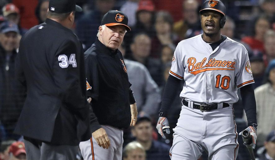 Baltimore Orioles' Adam Jones (10) yells at home plate umpire Sam Holbrook (34) after being ejected for arguing a strikeout during the fifth inning of a baseball game at Fenway Park in Boston, Wednesday, May 3, 2017. At center is Baltimore Orioles manager Buck Showalter. (AP Photo/Charles Krupa)