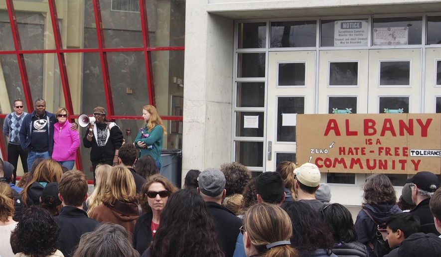 In this March 26, 2017 photo, people attend a rally for the Albany for All to support unity and inclusiveness in response to racist and offensive posted on social media, at Albany High School in Albany, Calif. Four Albany High School students sued a school district after they were suspended over their responses to Instagram posts that included a black student and coach with nooses around their necks. (Chris Treadway/East Bay Times via AP)