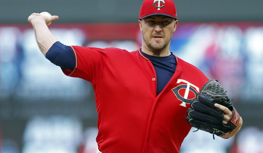 Minnesota Twins pitcher Phil Hughes throws against the Boston Red Sox in the first inning of a baseball game Friday, May 5, 2017, in Minneapolis. (AP Photo/Jim Mone)