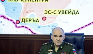Col. Gen. Sergei Rudskoi of the Russian General Staff, speaks to the media in the Defense Ministry in Moscow, Russia, Friday, May 5, 2017. Russia's military says the agreement setting up four de-escalation zones in Syria will go into effect at midnight. The military also says the deal, which was signed by Russia, Iran and Turkey in Kazakhstan the day before, could be extended to more areas of the war-torn country. (AP Photo/Pavel Golovkin)