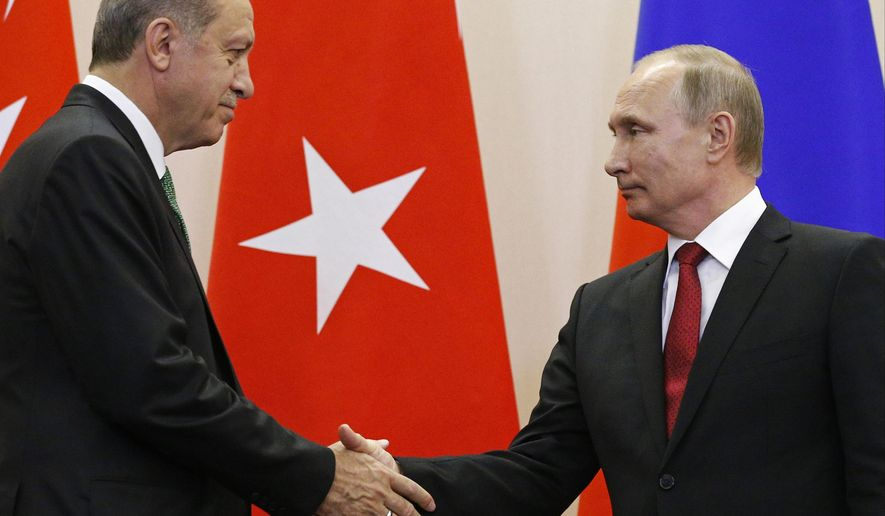 Russian President Vladimir Putin, right, and Turkish President Recep Tayyip Erdogan shake hands after a news conference following their talks in Putin's residence in the Russian Black Sea resort of Sochi, Russia, Wednesday, May 3, 2017. The presidents of Russia and Turkey are holding talks on the situation in Syria and also the restoration of full economic ties between their two countries. (AP Photo/Alexander Zemlianichenko, Pool)