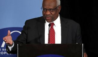 Supreme Court Justice Clarence Thomas speaks at the Bar Association of Metropolitan St. Louis, Friday, May 5, 2017, in St. Louis. (AP Photo/Jeff Roberson)