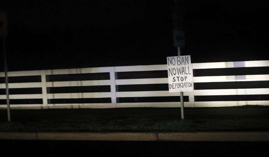 A handmade sign is seen along the motorcade route transporting President Donald Trump, Thursday, May 4, 2017, in Bedminster, N.J. Trump is spending the weekend at nearby Trump National Golf Course. (AP Photo/Pablo Martinez Monsivais)