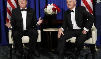 In this May 4, 2017, photo, President Donald Trump meets with Australian Prime Minister Malcolm Turnbull aboard the USS Intrepid, a decommissioned aircraft carrier docked in the Hudson River in New Yor. (AP Photo/Pablo Martinez Monsivais)