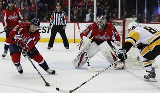 Washington Capitals defenseman Dmitry Orlov (9), from Russia, goalie Braden Holtby (70), defend as Pittsburgh Penguins right wing Phil Kessel (81) moves in during the first period of Game 5 in the second-round of the NHL hockey Stanley Cup playoffs, Saturday, May 6, 2017, in Washington. (AP Photo/Carolyn Kaster)