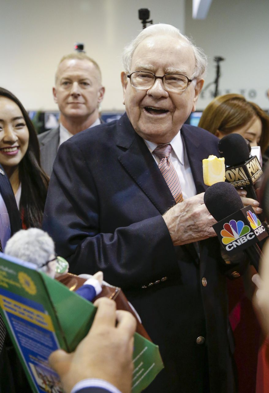 Warren Buffett, Berkshire Hathaway Chairman and CEO, smiles when presented with a talking Warren doll made by Genius Brands International, as he tours the exhibit floor at the CenturyLink Center in Omaha, Neb., Saturday, May 6, 2017, where company subsidiaries display their products. (AP Photo/Nati Harnik) ** FILE **
