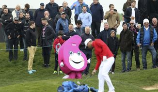 A mascot is displayed as Denmark's Lucas Bjerregaard prepares to make a shot, during day one of the Golf Sixes at the Centurion Club, in St Albans, England, Saturday May 6, 2017. The European Tour rolls out its latest innovative tournament, the six-hole GolfSixes event featuring two-man teams from 16 different countries. (Steven Paston/PA via AP)