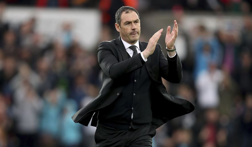 Swansea City manager Paul Clement applauds after the final whistle of the English Premier League soccer match, Swansea City against Everton at the Liberty Stadium, Swansea, Wales,  Saturday May 6, 2017. (David Davies/PA via AP)