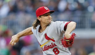 St. Louis Cardinals starting pitcher Mike Leake (8) works against the Atlanta Braves in the first inning of a baseball game Saturday, May 6, 2017, in Atlanta. (AP Photo/John Bazemore)