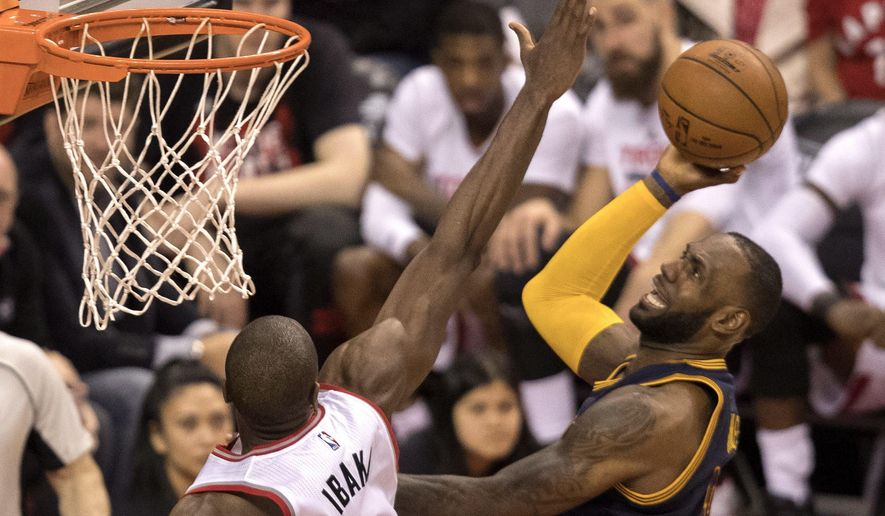Cleveland Cavaliers forward LeBron James (23) shoots over Toronto Raptors forward Serge Ibaka (9) during the second half of Game 3 of an NBA basketball second-round playoff series in Toronto on Friday, May 5, 2017. (Fred Thornhill/The Canadian Press via AP)