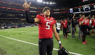 FILE - In this Nov. 25, 2016, file photo, Texas Tech quarterback Patrick Mahomes II celebrates after Tech defeated Baylor in an NCAA college football game in Arlington, Texas. When Kansas City Chiefs general manager John Dorsey and coach Andy Reid boldly jumped up 17 spots to select Mahomes with the 10th overall pick last week, they did so gambling that he will be their franchise quarterback long into the future.  (AP Photo/Ron Jenkins, File)