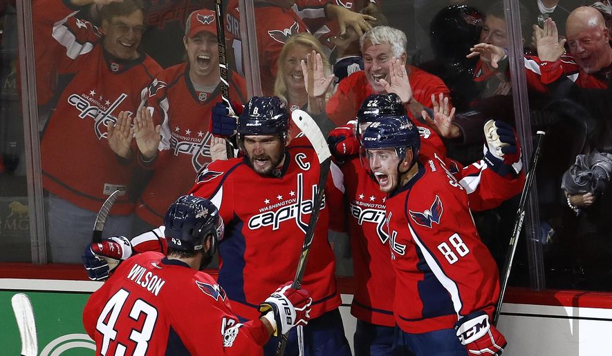 CORRECTS SPELLING OF CAPITALS IN SECOND SENTENCE Washington Capitals left wing Alex Ovechkin (8), from Russia, celebrates scoring a goal against the Pittsburgh Penguins with teammates Tom Wilson (43), Kevin Shattenkirk (22), and Nate Schmidt (88), during the third period of Game 5 in the second-round of the NHL hockey Stanley Cup playoffs, Saturday, May 6, 2017, in Washington. The Capitals won 4-2. (AP Photo/Carolyn Kaster)