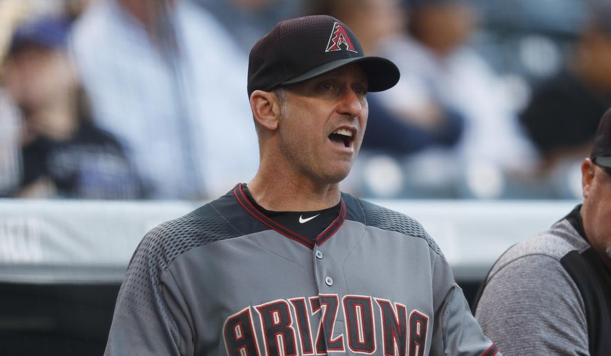 Arizona Diamondbacks manager Torey Lovullo directs his team against the Colorado Rockies in the first inning of a baseball game, Saturday, May 6, 2017, in Denver. (AP Photo/David Zalubowski) **FILE**