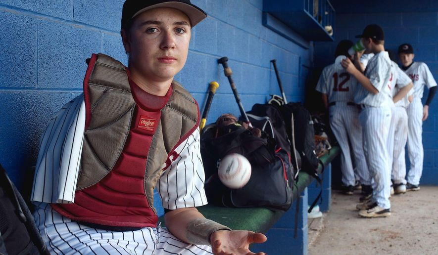 In this Wednesday, April 19, 2017 photo, eighth-grader Luke Terry the catcher for the Cornersville Middle School baseball team poses for a photo in Lewisburg, Tenn. Luke had his right arm amputated at 19 months. He had contracted E. coli and it eventually attacked the arm. (Helen Comer/The Daily News Journal via AP)