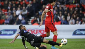 PSG's Edinson Cavani is tackled by Bastia's Alexander Djiku during the French League One soccer match between PSG and Bastia at the Parc des Princes stadium in Paris, France, Saturday, May 6, 2017. (AP Photo/Kamil Zihnioglu)