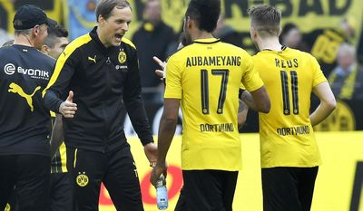 Dortmund's head coach Thomas Tuchel reacts to his scorers Pierre-Emerick Aubameyang and Marco Reus after winning the German Bundesliga soccer match between Borussia Dortmund and TSG Hoffenheim in Dortmund, Germany, Saturday, May 6, 2017. Dortmund defeated Hoffenheim with 2-1. (AP Photo/Martin Meissner)