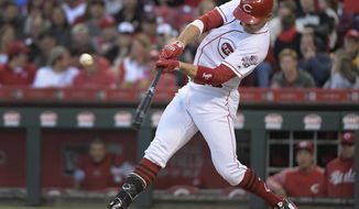 Cincinnati Reds' Joey Votto hits a double that scored Billy Hamilton during the third inning of a baseball game against the San Francisco Giants, Saturday, May 6, 2017, in Cincinnati. (AP Photo/Michael E. Keating)