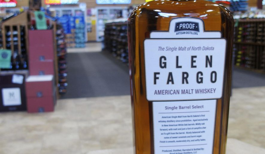 This Wednesday, May 3, 2017 photo shows a bottle of Glen Fargo American Malt Whiskey at Happy Harry's Bottle Shop in Fargo, N.D. Proof Artisan Distillers received approval from the U.S. Patent and Trademark Office for its Glen Fargo American Malt Whiskey, after a challenge from Scottish distillers. (AP Photo/Dave Kolpack)
