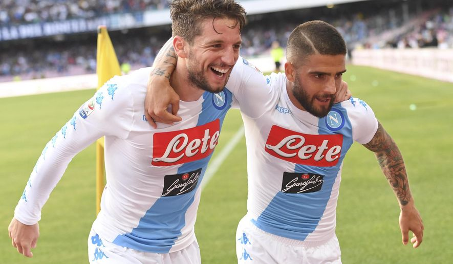 Napoli forward Lorenzo Insigne, right, celebrates with his teammate Dries Mertens after scoring a goal during the Italian Serie A soccer match between Napoli and Cagliari, at the San Paolo stadium in Naples, Italy, Saturday, May 6, 2017. (Ciro Fusco/ANSA via AP)