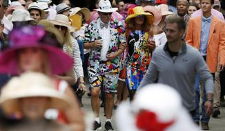 Fans arrive for the 143rd running of the Kentucky Derby horse race at Churchill Downs Saturday, May 6, 2017, in Louisville, Ky. (AP Photo/John Minchillo)