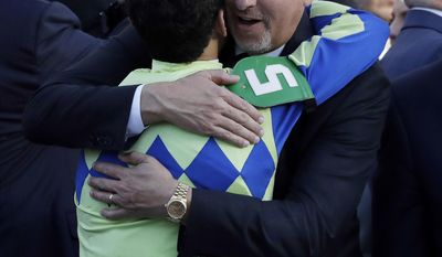 Trainer Todd Pletcher hugs jockey John Velazquez he rode Always Dreaming to victory in the 143rd running of the Kentucky Derby horse race at Churchill Downs Saturday, May 6, 2017, in Louisville, Ky. (AP Photo/Garry Jones)