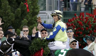 John Velazquez celebrates after riding Always Dreaming to victory in the 143rd running of the Kentucky Derby horse race at Churchill Downs Saturday, May 6, 2017, in Louisville, Ky. (AP Photo/Garry Jones)