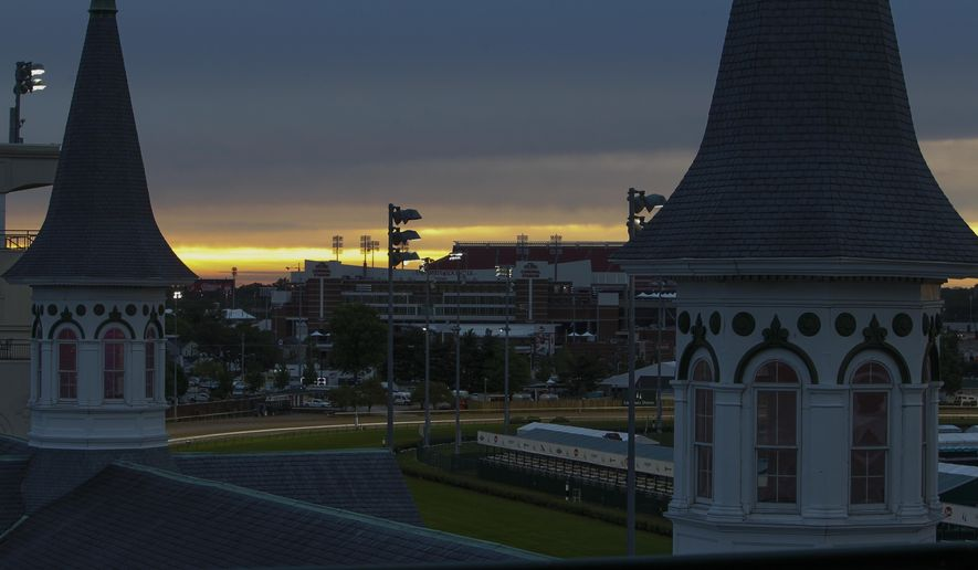 The sun rises at Churchill Downs before the 143rd running of the Kentucky Derby horse race Saturday, May 6, 2017, in Louisville, Ky. (AP Photo/Garry Jones)