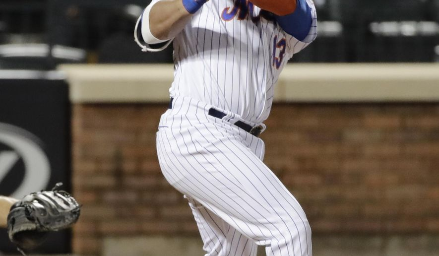 New York Mets' Asdrubal Cabrera follows through on his RBI-single during the seventh inning of a baseball game against the Miami Marlins, Friday, May 5, 2017, in New York. The Mets won 8-7. (AP Photo/Frank Franklin II)