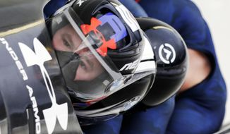FILE - In this Jan. 9, 2016, file photo, driver Steven Holcomb with Frank Delduca, Carlo Valdes and brakeman Samuel McGuffie, compete in the four-man bobsled World Cup race in Lake Placid, N.Y.  Holcomb, the longtime U.S. bobsledding star who drove to three Olympic medals after beating a disease that nearly robbed him of his eyesight, was found dead in Lake Placid, N.Y., on Saturday, May 6, 2017.  He was 37. (AP Photo/Mike Groll, File)