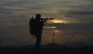 A Pakistani border security guard stands alert at Pakistan-Afghanistan border post, Chaman in Pakistan, Friday, May 5, 2017.  Backed by artillery, Afghan security forces fired across the border on Pakistani census workers and troops escorting them on Friday, killing many people and drawing a response from the military, Pakistan said. On the Afghan side, officials reported that scores of people killed in the incident, a significant escalation of hostilities between the two neighbours. (AP Photo/Matiullah Achakzai)