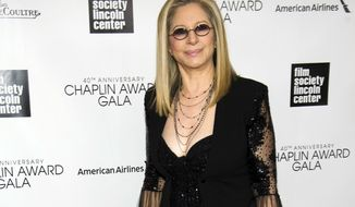 FILE - In this April 22, 2013 file photo, honoree Barbra Streisand attends the Film Society of Lincoln Center's 40th Annual Chaplin Award Gala in New York. Streisand usually talks to her audience, but she had a special message for two guests at her concert: Bill and Hillary Clinton. Streisand gave the former president and former Democratic presidential nominee much more than a shout out Saturday, May 6, 2017, at the Barclays Center in Brooklyn, her hometown. (Photo by Charles Sykes/Invision/AP, File)
