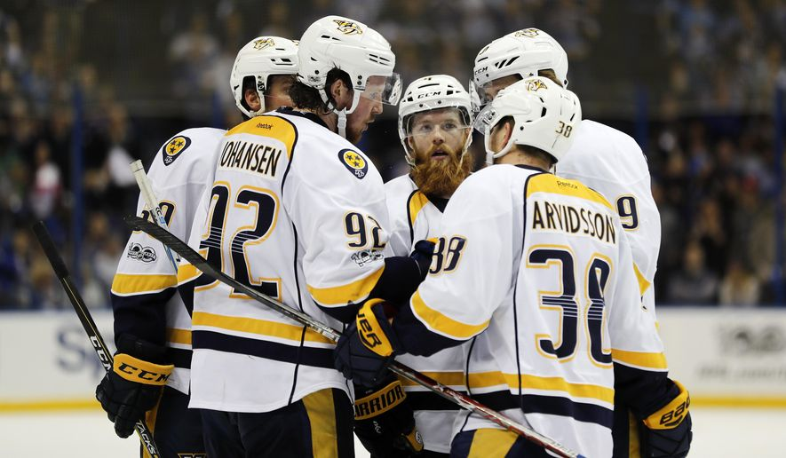 Nashville Predators players, including Ryan Johansen (92); Ryan Ellis, center; and Viktor Arvidsson (38), of Sweden; confer during the third period in Game 5 of an NHL hockey second-round playoff series against the St. Louis Blues Friday, May 5, 2017, in St. Louis. (AP Photo/Jeff Roberson)