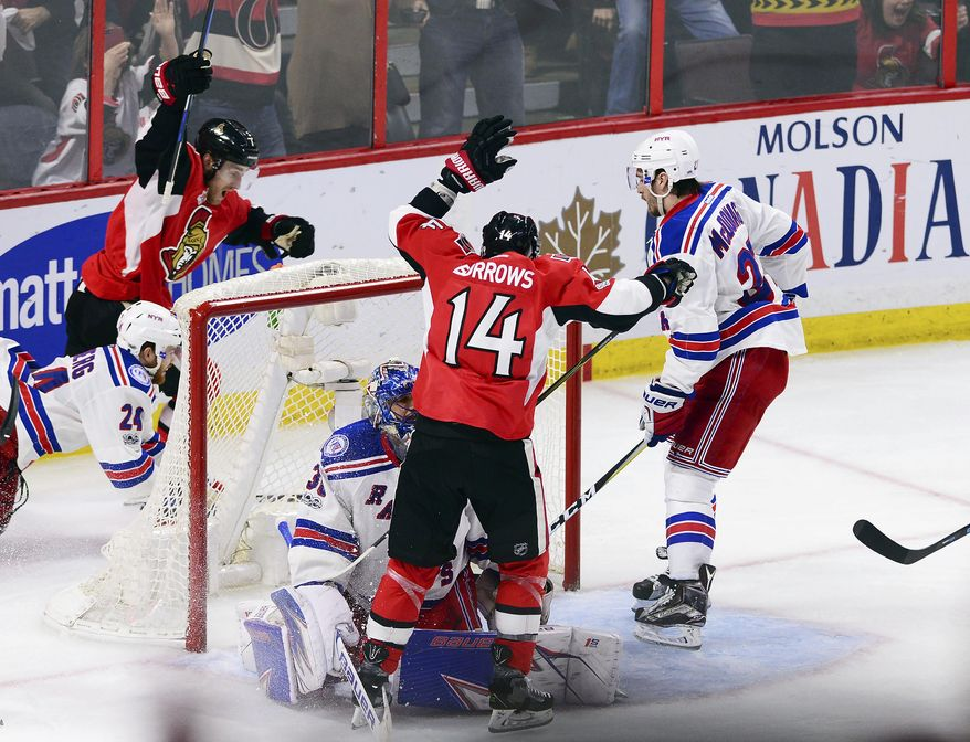 Ottawa Senators center Kyle Turris, top left, and Alex Burrows (14) celebrate after Turris scored the game-winning goal during overtime against the New York Rangers in Game 5 in the second round of the NHL hockey Stanley Cup playoffs in Ottawa on Saturday, May 6, 2017. The Senators won 5-4 in overtime.(Sean Kilpatrick/The Canadian Press via AP)