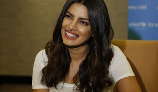 "Actress Priyanka Chopra is photographed during an interview with the Associated Press in Johannesburg, Saturday, May 6, 2017. Chopra said after visiting Zimbabwe Friday as a UNICEF goodwill ambassador she is dismayed by the level of sexual violence against children in Zimbabwe. She says government officials there told her many young girls are ""asking for it."" (AP Photo/Denis Farrell)"