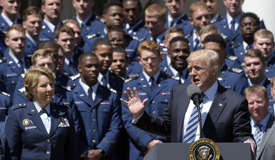 Air Force Academy Superintendent Lt. Gen. Michelle Johnson, left, and football team members, listens as President Donald Trump speaks in the Rose Garden of the White House in Washington, Tuesday, May 2, 2017, during a presentation ceremony of the Commander-in-Chief trophy to the Air Force Academy football team. (AP Photo/Susan Walsh)
