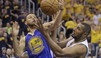 Golden State Warriors guard Stephen Curry (30) and Utah Jazz center Boris Diaw, right, battle for a rebound in the first half during Game 3 of the NBA basketball second-round playoff series Saturday, May 6, 2017, in Salt Lake City. (AP Photo/Rick Bowmer)