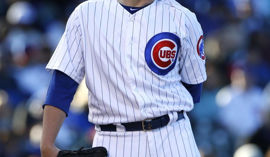 Chicago Cubs starting pitcher Brett Anderson reacts after New York Yankees' Aaron Hicks bunted during the first inning of an interleague baseball game Saturday, May 6, 2017, in Chicago. (AP Photo/Nam Y. Huh)