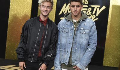 Jack Johnson, left, and Jack Gilinsky arrive at the MTV Movie and TV Awards at the Shrine Auditorium on Sunday, May 7, 2017, in Los Angeles. (Photo by Jordan Strauss/Invision/AP)