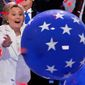 Then-presidential nominee Hillary Clinton reaches for a falling balloon at the conclusion of the 2016 Democratic National Convention in Philadelphia. (Associated Press)