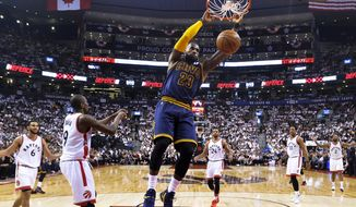 Cleveland Cavaliers forward LeBron James (23) slam dunks the ball past Toronto Raptors forward Serge Ibaka (9) during first half eastern conference semi-final NBA basketball action in Toronto on Sunday, May 7, 2017. (Nathan Denette/The Canadian Press via AP)