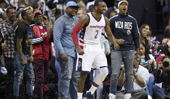 Washington Wizards guard John Wall (2) reacts during the second half in Game 4 of a second-round NBA basketball playoff series against the Boston Celtics, Sunday, May 7, 2017, in Washington. (AP Photo/Nick Wass)