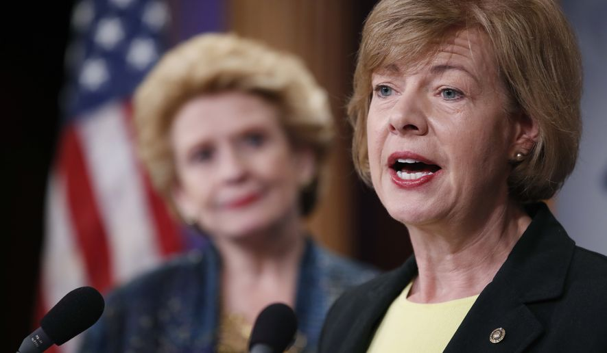 Sen. Tammy Baldwin (right), Wisconsin Democrat, accompanied by Sen. Debbie Stabenow, Michigan Democrat, speaks on Capitol Hill in Washington during a April 25, 2017, news conference to discuss President Donald Trump's first 100 days. (Associated Press) **FILE**