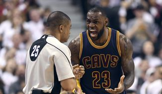 Cleveland Cavaliers forward LeBron James (23) argues over a call with referee Tony Brothers during the second half of Game 4 of a second-round NBA basketball playoff series against the Toronto Raptors in Toronto, Sunday, May 7, 2017. (Frank Gunn/The Canadian Press via AP)