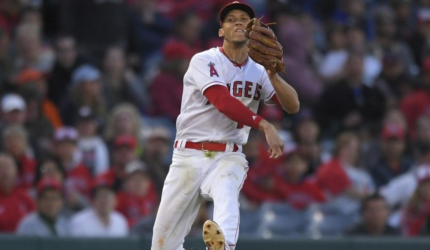 Los Angeles Angels shortstop Andrelton Simmons attempts to throw out Houston Astros' George Springer at first base during a baseball game, Saturday, May 6, 2017, in Anaheim, Calif. Springer was safe on the play. (AP Photo/Mark J. Terrill)
