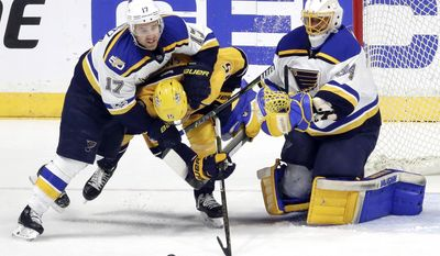 St. Louis Blues left wing Jaden Schwartz (17) slows down Nashville Predators right wing Craig Smith (15) as Blues goalie Jake Allen (34) watches during the first period in Game 6 of a second-round NHL hockey playoff series Sunday, May 7, 2017, in Nashville, Tenn. (AP Photo/Mark Humphrey)