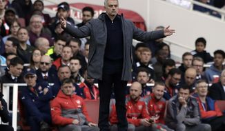 Manchester United manager Jose Mourinho gestures during the English Premier League soccer match between Arsenal and Manchester United at the Emirates stadium in London, Sunday, May 7, 2017. (AP Photo/Matt Dunham)