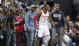 Washington Wizards guard John Wall (2) reacts during the second half in Game 4 of a second-round NBA basketball playoff series against the Boston Celtics, Sunday, May 7, 2017, in Washington. (AP Photo/Nick Wass) **FILE**