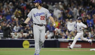 Los Angeles Dodgers starting pitcher Clayton Kershaw (22) reacts as San Diego Padres' Ryan Schimpf rounds the bases after hitting a home run eighth inning of a baseball game Saturday, May 6, 2017, in San Diego. (AP Photo/Gregory Bull)