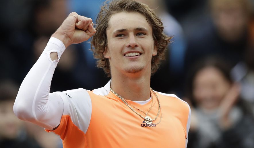 Alexander Zverev of Germany celebrates after winning his final match against Guido Pella of Argentina at the ATP tennis tournament in Munich, Germany, Sunday, May 7, 2017. (AP Photo/Matthias Schrader)